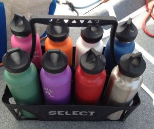 Team Intact water bottles in their water bottle cady.